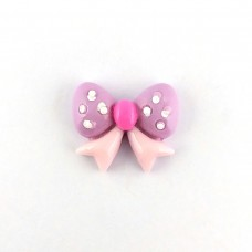 Purple polka dot bow with a pink center