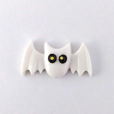 White bat with black eyes